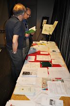 Photo: Jeff Robbins and David Berger at the freebie table, now with a lot more haiku sheets and other handouts.