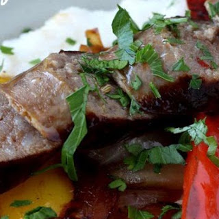 Italian Sausages with Peppers Over Cheesy Polenta Recipe