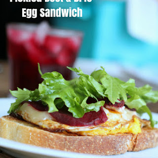 Open-faced Pickled Beet and Brie Egg Sandwich.