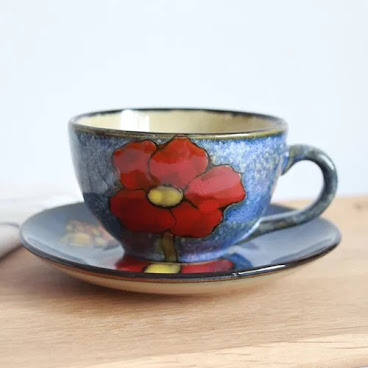 Dark blue flower cup & saucer