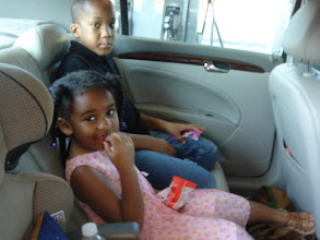 Photo: kids snacking in the car