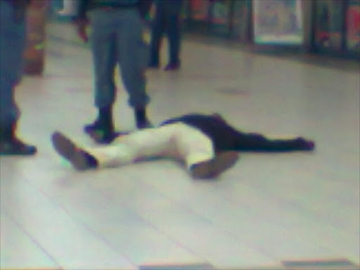 The body of a man who was killed at Kagiso Mall.