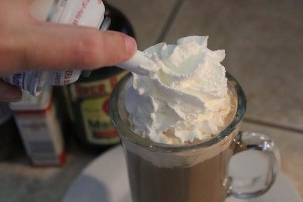 Garnish coffee with the Reddi Whip.