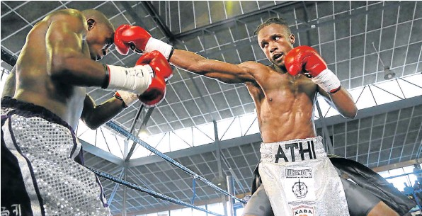 ON THE BUTTON: Athi Dumezweni leads with a straight left to the head of Lindile Tshemese during their title fight held in Mdantsane Sunday,