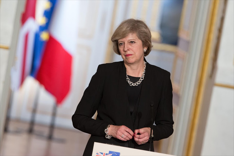 British Prime Minister Theresa May at a press conference in France.