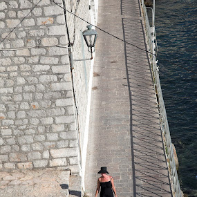 Caron on Hydra, Greece by Gordon Coldwell - People Street & Candids