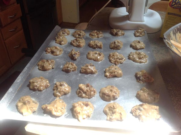 Using a tablespoon drop dough onto prepared cookie sheet, and space about 2-3 inches...