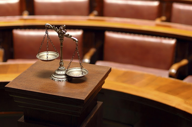 Scales of justice in a court of law. File photo.