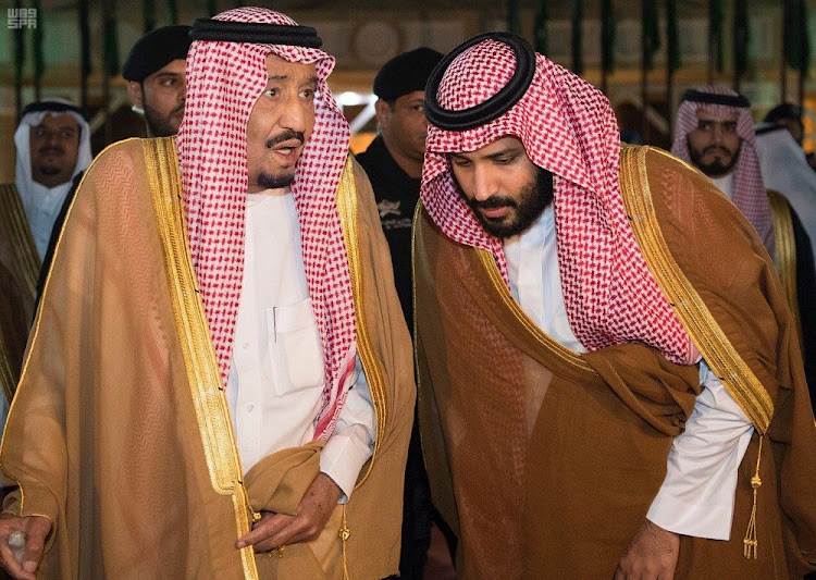 Saudi Arabia's King Salman bin Abdulaziz Al Saud chats with his son and Crown Prince Mohammed bin Salman, before King Salman left for Medina, in Riyadh, Saudi Arabia, November 8 2017. Picture: REUTERS