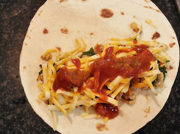 Spray baking dish with cooking spray. Lay out tortillas. Spoon 3-4 tablespoons of meat/spinach...