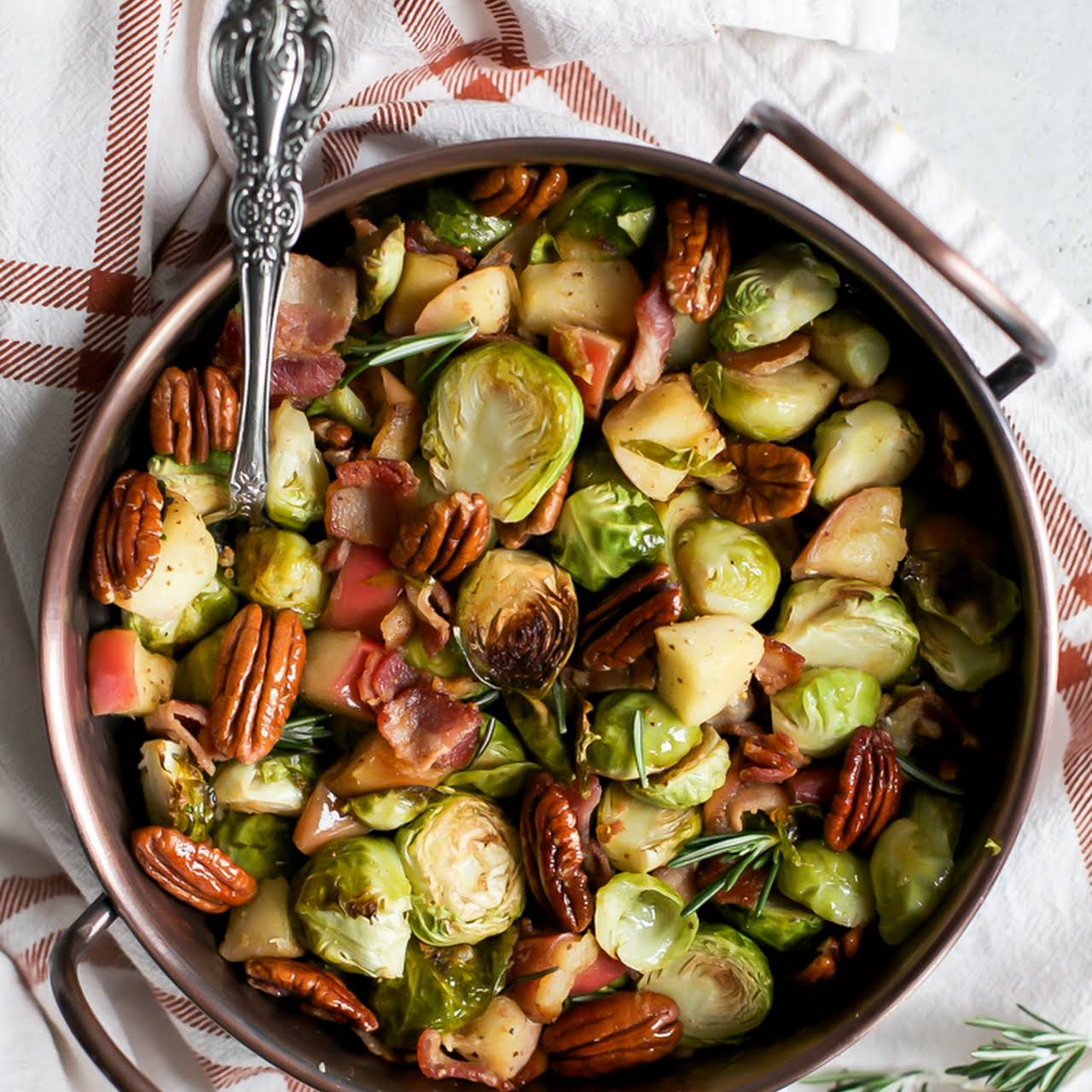 Roasted Brussels Sprouts  behind Sautéed Apples & Bacon paleo-friendly