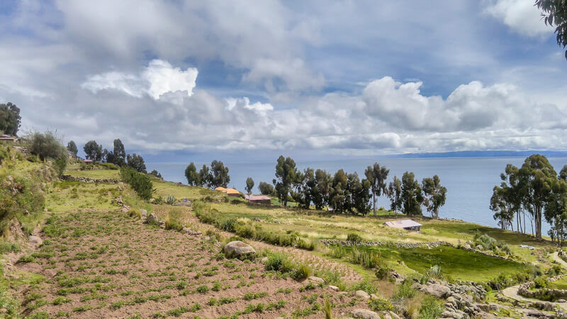 view of fields terraced roofs from the taquile island near puno lake titicaca peru