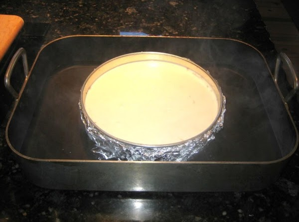 Place pan in roasting pan, fill with hot water to about 1/2 up springform...