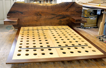 Photo: http://dorsetcustomfurniture.blogspot.com/2011/03/walnut-slab-bed.html