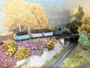 Photo: 007 The same train heading across the flyover. Note the realistic heather and gorse, watch out for adders! .