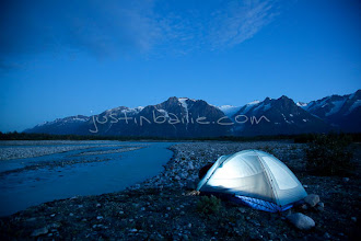 """Photo: View of tent as seen while on raft trip down the Tashenshini River. The """"Tat"""" flows out of Yukon, CA, through British Columbia and empties into Glacier Bay National Park in Alaska, US."""