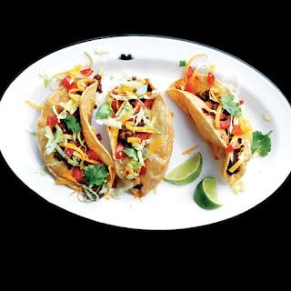 Beef Picadillo Puffy Tacos.