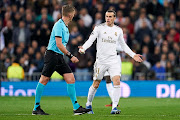 Gareth Bale of Real Madrid argue with referee during the UEFA Champions League round of 16 first leg match between Real Madrid and Manchester City at Bernabeu on February 26, 2020 in Madrid, Spain.