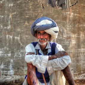 In blue & white by Aparajita Saha - People Portraits of Men ( pushkar fair, camel vendor, turban, old man, india )