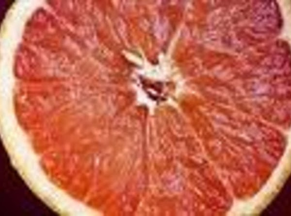Use a knife to remove the skin and any pith from the grapefruit flesh...