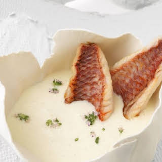 White Garlic Bisque with Fish.