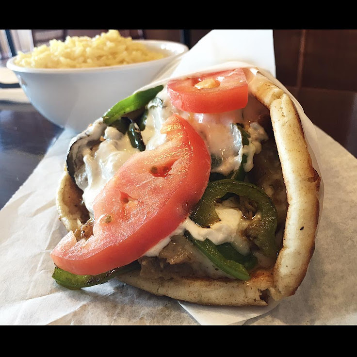 The Philly cheese steak/lamb with the side of Greek rice. Photo: Alan Liang.