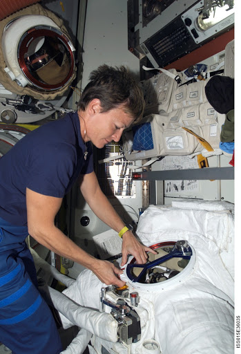 Expedition 16 CDR Whitson works with an EMU