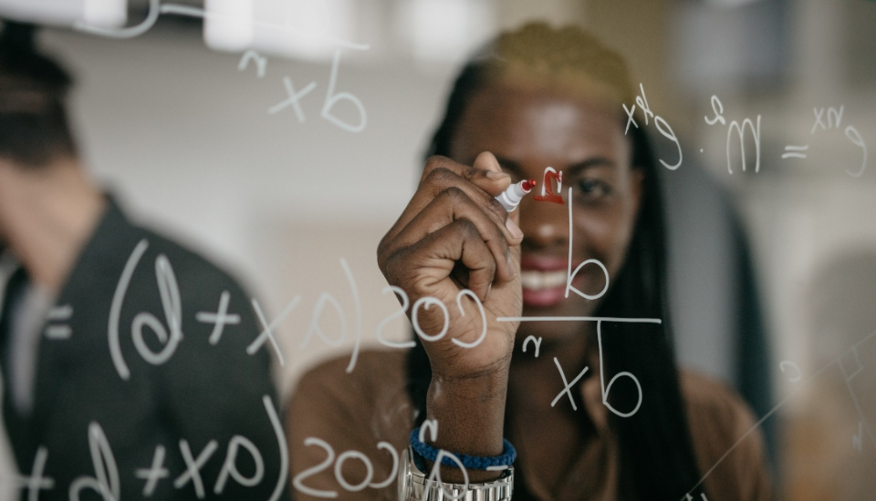 image of a woman calculating keyword density on a glass board