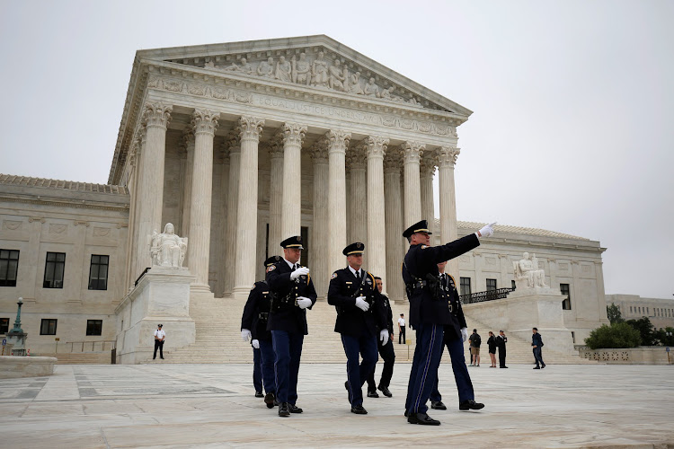 Police officers walk on the plaza of the Supreme Court in Washington US