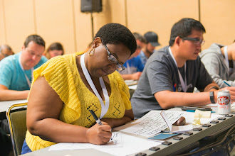 Photo: And asked attendees to put away their technology and get analog with pen and paper.