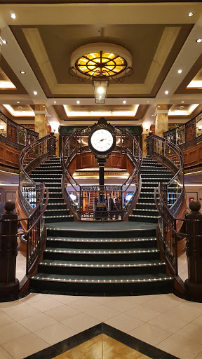 Queen-Victoria-Queens-Arcade - The Queens Arcade on deck 3 of Queen Victoria, inspired by the Royal and Burlington Arcades in London, features a grand staircase.