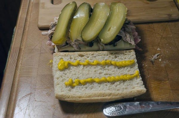 Add two more lines of mustard to the top of the bun.