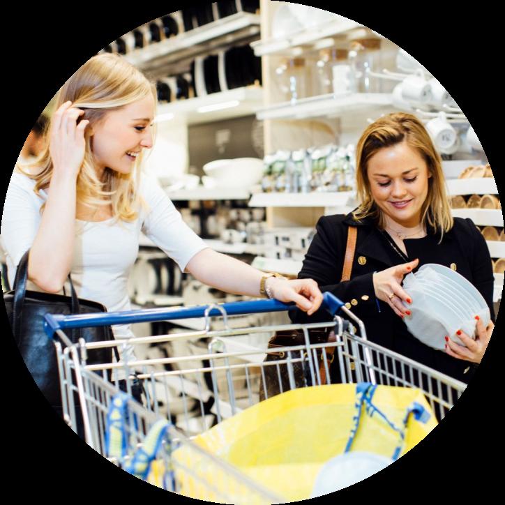 Two women looking at bowls at IKEA