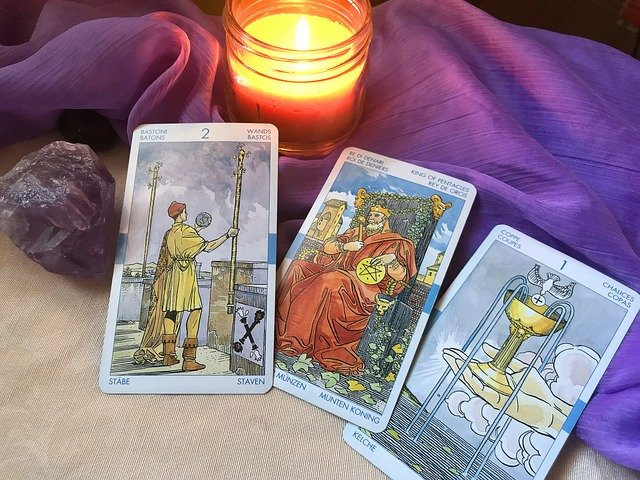 Tarot Card Reader with  a candle