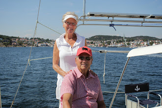 Photo: After a big lunch on board in Lillesand harbour Susanne and Frode sail with us to their house on Tromøya. Lillesand in the background.