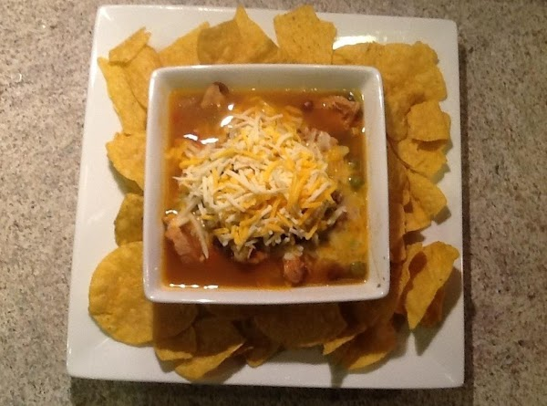 Top with cheese and serve with tortilla chips.