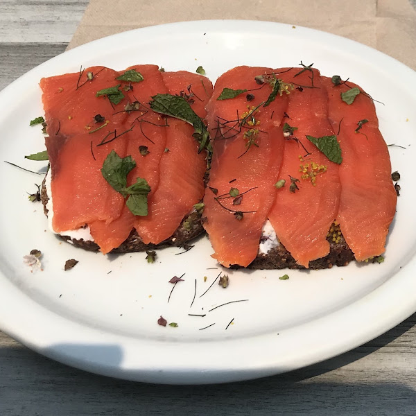 Smoked salmon and cream cheese on house-made, gluten-free bread with fresh-picked herbs