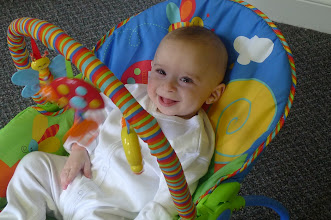 Photo: 5.5 months old, in his new swing.