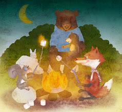 Photo: Friends around a campfire.