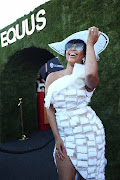 Minnie Dlamini arrived at The Vodacom Durban July in a sassy white dress and hat.
