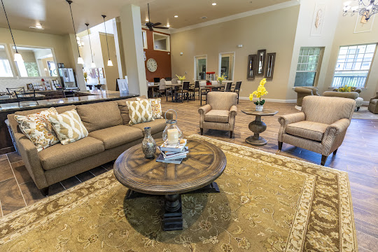 Clubhouse with couches, chairs, and tables for lounging