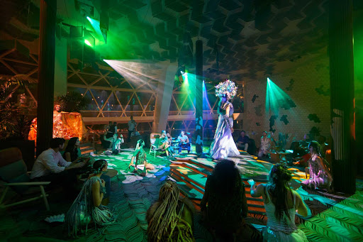 Edenists serve a choreographed series of experiential culinary fare and pop-up entertainment experiences on Celebrity Edge class ships.