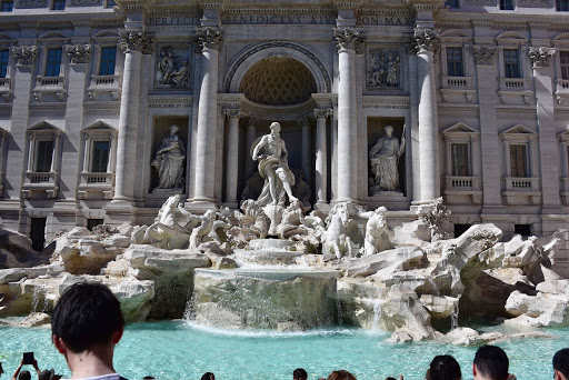 trevi-fountain-with-tourists.jpg - Trevi Fountain, a popular tourist spot, is an example of Baroque architecture. It opened in 1762.