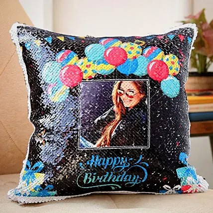 """A """"Happy Birthday"""" sequin cushion from FNP that can be personalized with customer photos."""