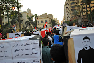 Photo: A view of the many caskets as the march makes its way down Kasr Al Ainy St.
