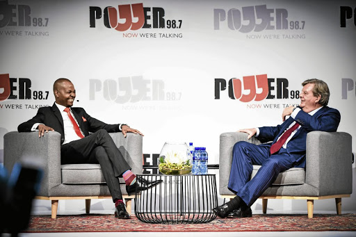 The writer says it's absurd to suggest that billionaire Johann Rupert, above with Given Mkhari, was out to insult black people on 'Chairman's Conversation' on Power FM on Tuesday night.