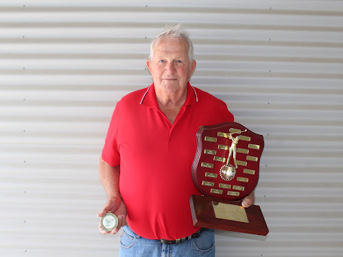 A very proud and excited Milton Scaysbrook holding the Burke Shield and his Golf NSW Central North District zone medal.