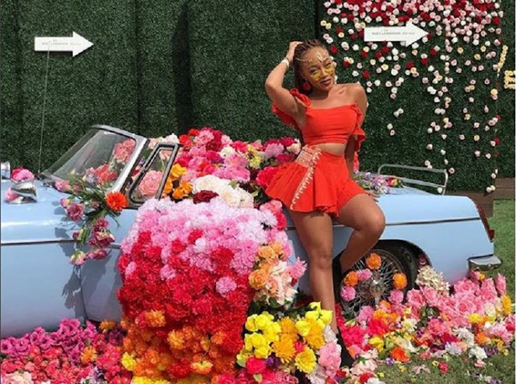 Thando Thabethe is currently attended the Revolve Festival in America.