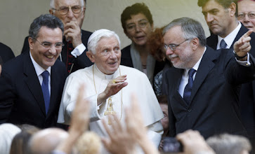 Photo: Pope Benedict XVI waves as he concludes a visit Nov. 12 to a home for the elderly run by the Sant'Egidio Community in Rome. At left is Marco Impagliazzo, president of the Community of Sant'Egidio, and at right Andrea Riccardi, founder of the community. (CNS photo/Paul Haring) (Nov. 12, 2012) See POPE-ELDERLY Nov. 12, 2012.