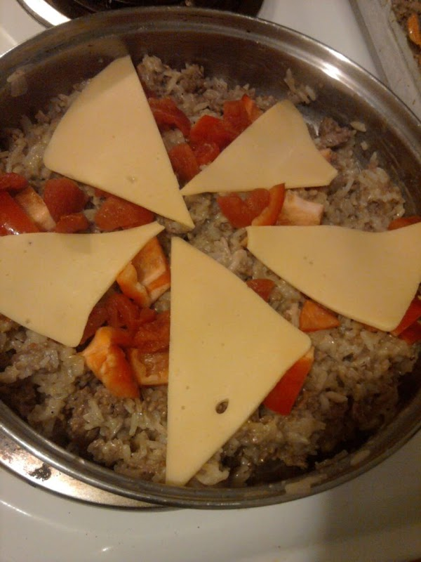 Top with the six cheese triangles, reduce heat and cover with lid just to...